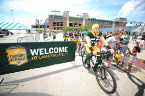 Packers Riding Bike to Training Camp